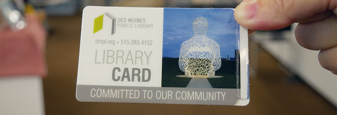 Person holding a DMPL library card