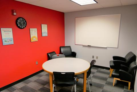 Large Study Room with circular table, chairs, and whiteboard