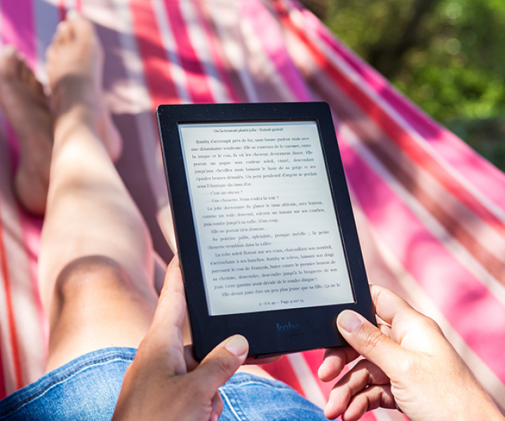 teen in hammock reading ebook on tablet